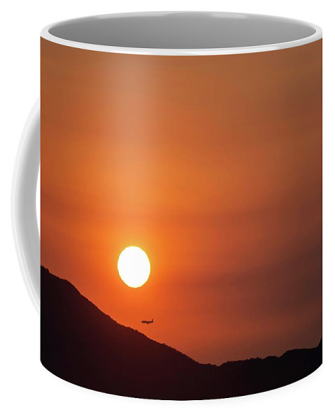 Sunset Coffee Mug featuring the photograph Red sunset and plane in flight by Hannes Roeckel