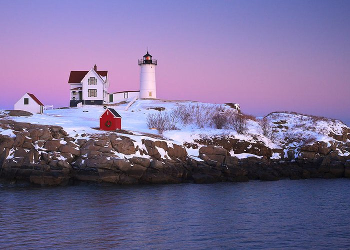 Atlantic Ocean Greeting Card featuring the photograph Nubble Light Under A Pastel Winter Sky by Jeff Sinon
