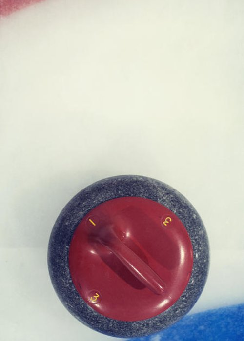 Curl Greeting Card featuring the photograph Red Curling Stone by Priska Wettstein