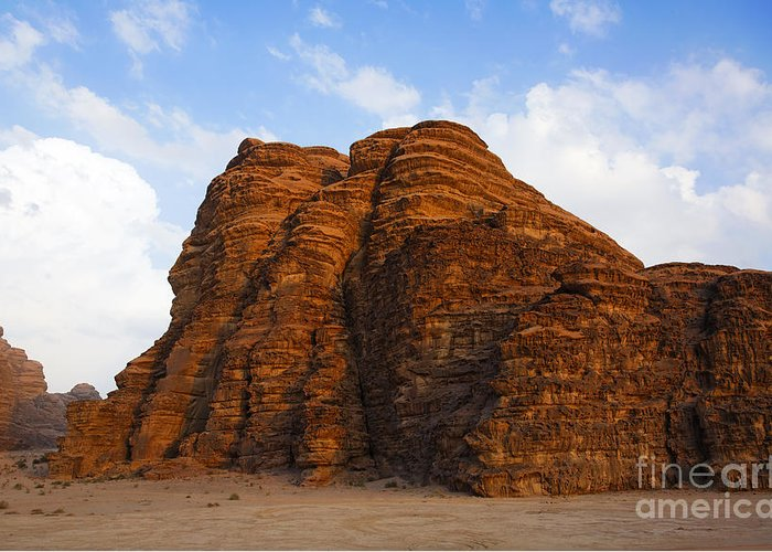 Wadi Rum Greeting Card featuring the photograph A Landscape Of Rocky Outcrops In The Desert Of Wadi Rum In Jordan by Robert Preston
