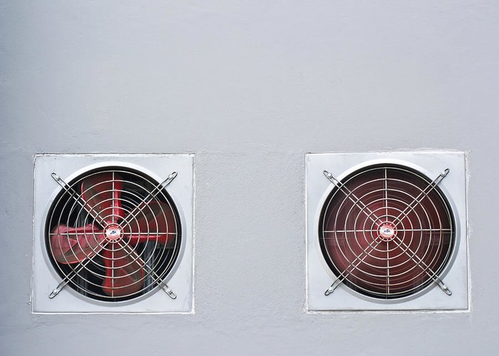 Air Greeting Card featuring the photograph A Pair Of Red Industrial Ventilated Fan On Grey Wall As Backgrou by Ammar Mas-oo-di