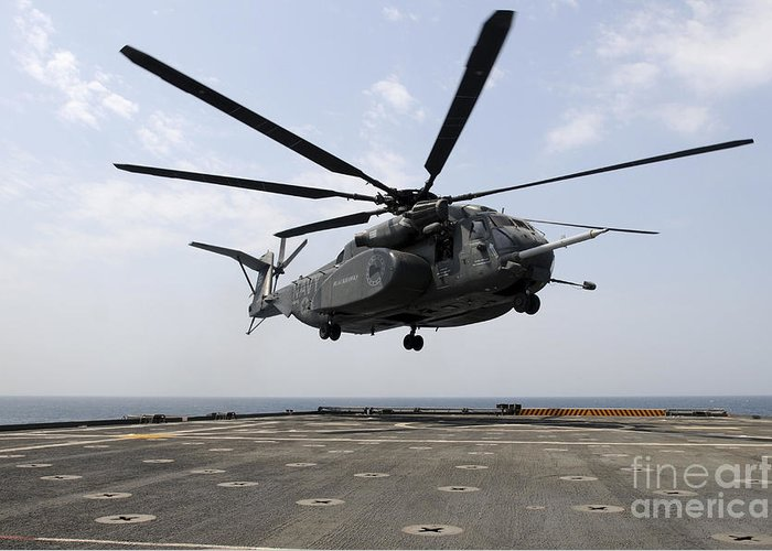 Military Greeting Card featuring the photograph An Mh-53e Sea Dragon Prepares To Land by Stocktrek Images