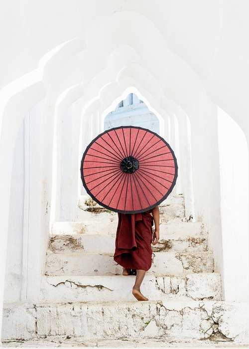 Steps Greeting Card featuring the photograph Buddhist Monk Walking Along Temple by Martin Puddy