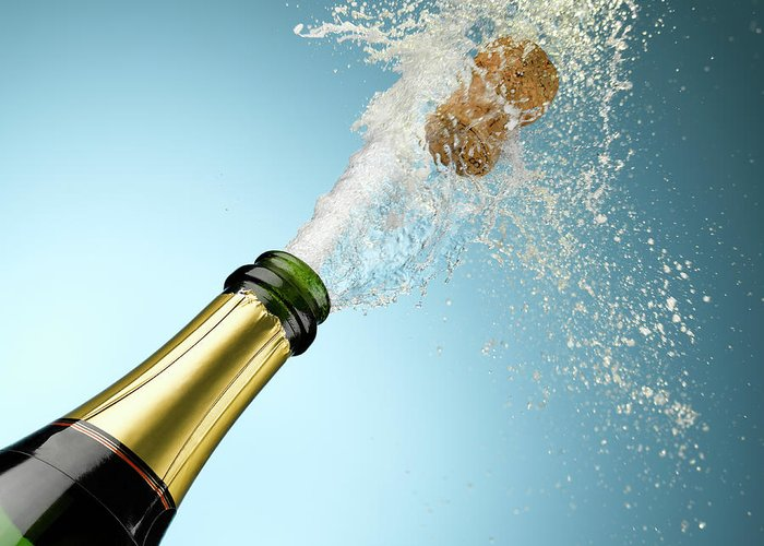 Celebration Greeting Card featuring the photograph Champagne And Cork Exploding From Bottle by Andy Roberts