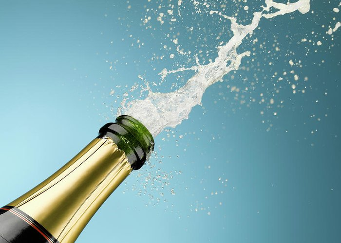 Celebration Greeting Card featuring the photograph Champagne Exploding From Bottle by Andy Roberts