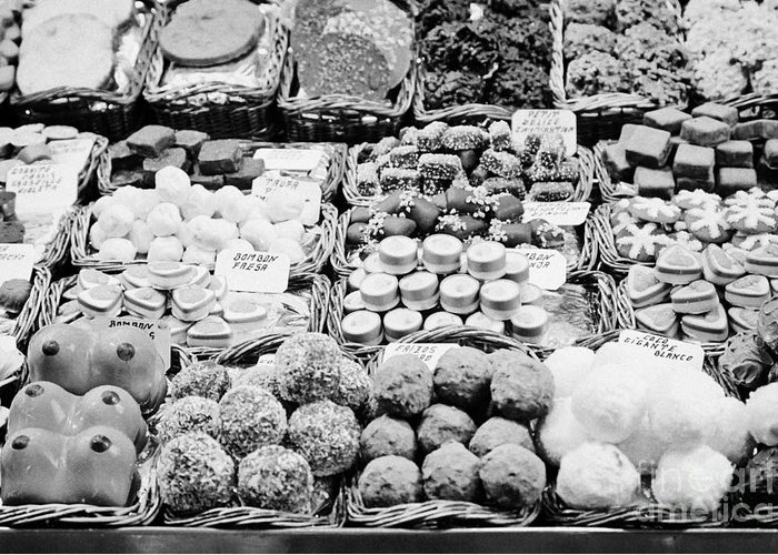 Food Greeting Card featuring the photograph chocolates on display inside the la boqueria market in Barcelona Catalonia Spain by Joe Fox