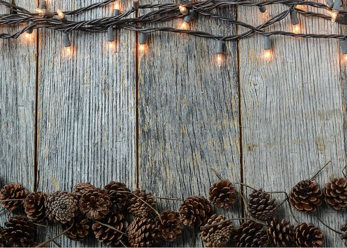 Christmas Lights And Pinecones On Rustic Wood Background Photograph By Brandon Bourdages Find the perfect rustic wood background stock illustrations from getty images. christmas lights and pinecones on rustic wood background by brandon bourdages