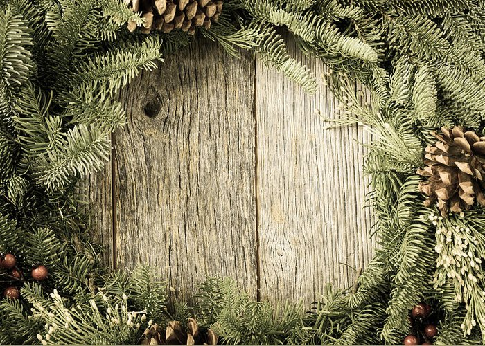 Advent Greeting Card featuring the photograph Christmas Wreath With Rustic Wood Background by Brandon Bourdages