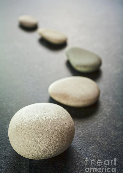 Stone Greeting Card featuring the photograph Curving Line Of Grey Pebbles On Dark Background by Colin and Linda McKie