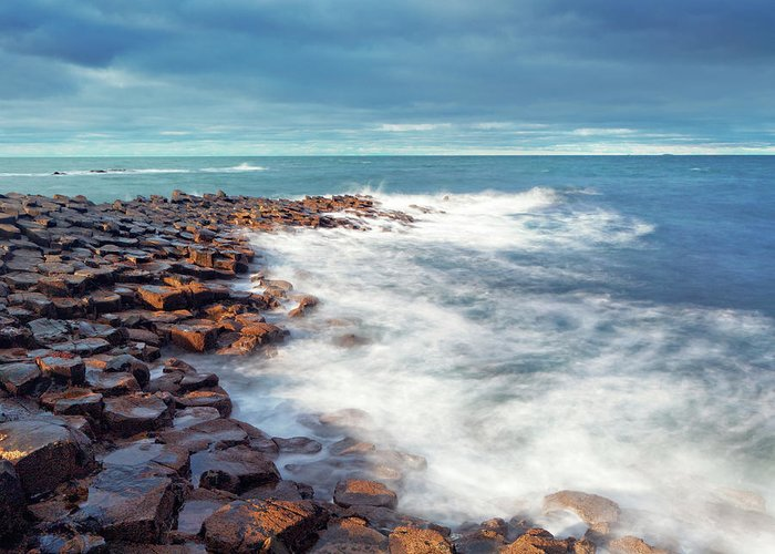 Water's Edge Greeting Card featuring the photograph Giants Causeway On A Cloudy Day by Mammuth