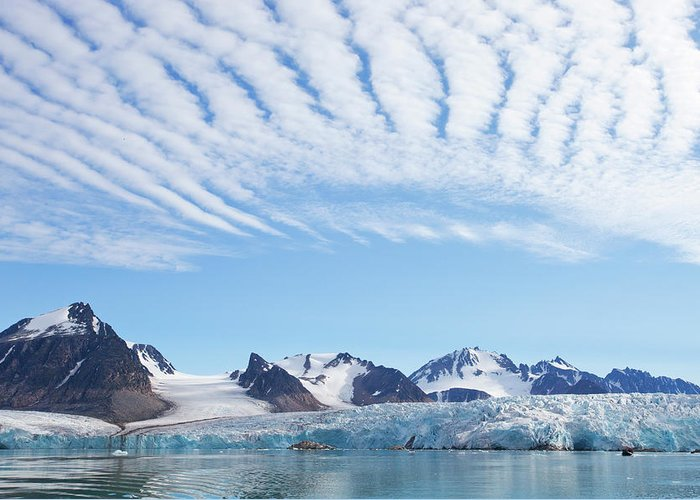 Scenics Greeting Card featuring the photograph Glaciers Tumble Into The Sea In The by Anna Henly