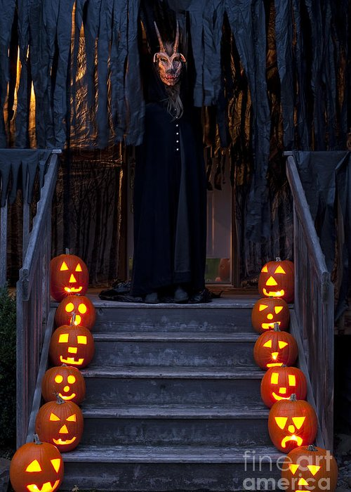 31st Greeting Card featuring the photograph Haunted House With Lit Pumpkins And Demon by Jim Corwin