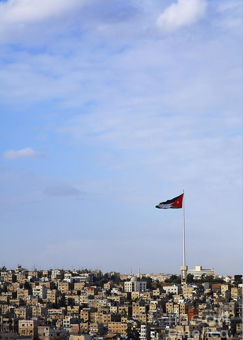 Flag Greeting Card featuring the photograph Jordanian Flag Flying Over The City Of Amman Jordan by Robert Preston