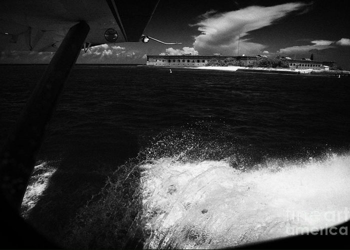Coming Greeting Card featuring the photograph Looking Out Of Seaplane Window Landing On The Water Next To Fort Jefferson Garden Key Dry Tortugas F by Joe Fox
