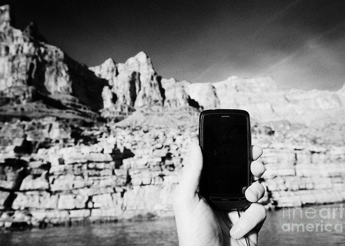 Man Greeting Card featuring the photograph man taking photos with smartphone during boat ride along the colorado river in the grand canyon Ariz by Joe Fox