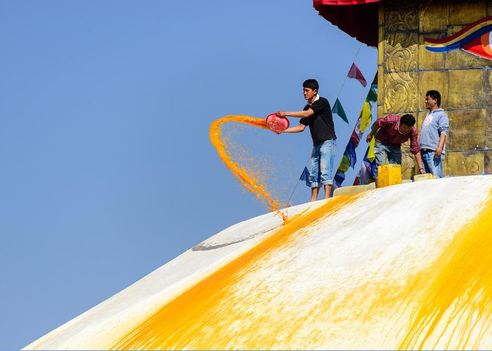 Bodnath Greeting Card featuring the photograph Man Throwing Orange Paint On Boudhanath Stupa by Dutourdumonde Photography