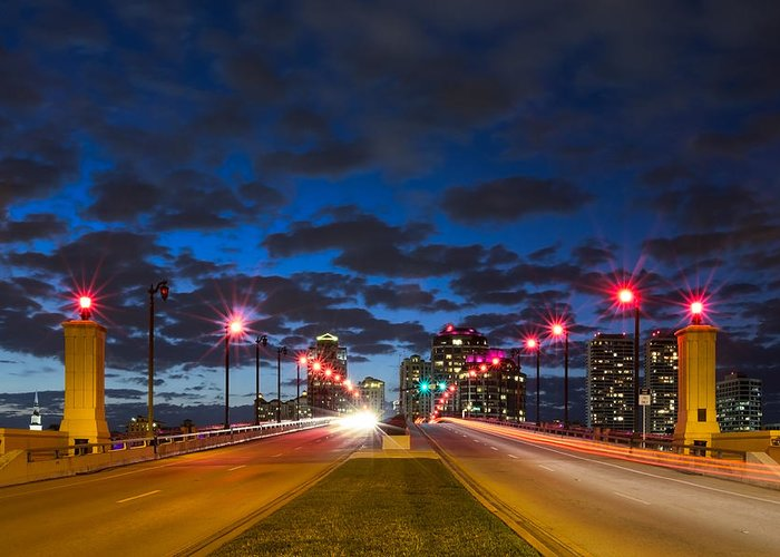 Clouds Greeting Card featuring the photograph Night Lights by Debra and Dave Vanderlaan