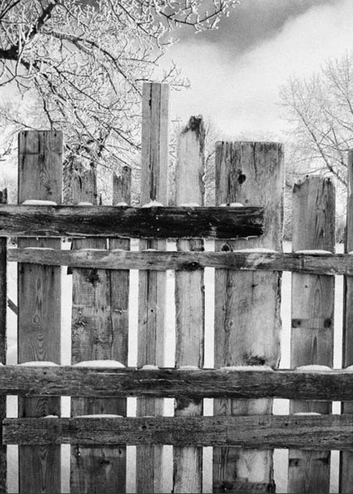 Old Greeting Card featuring the photograph old patched up wooden fence using old bits of wood in snow Forget Saskatchewan Canada by Joe Fox