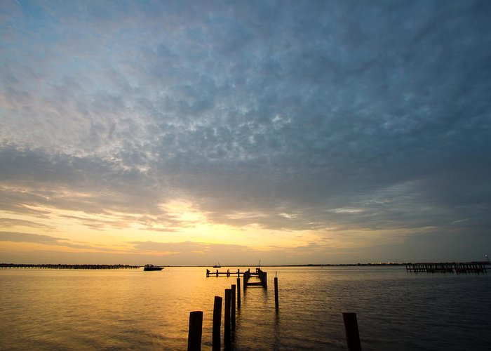 Sunset Greeting Card featuring the photograph Sunset At A Weathered Pier At Port Charlotte Harbor Near Punta by Fizzy Image