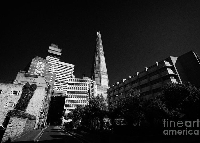 Shard Greeting Card featuring the photograph the shard building towering over local buildings including guys hospital in southwark London England by Joe Fox