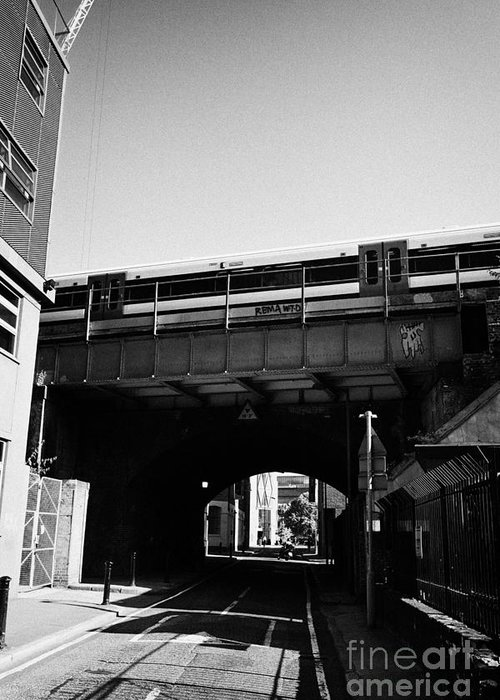 Train Greeting Card featuring the photograph train going over railway bridge elevated section of track southwark London England UK by Joe Fox