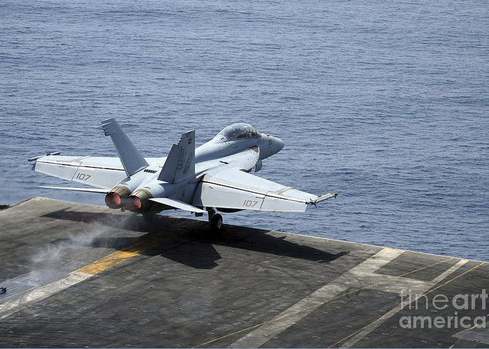 Military Greeting Card featuring the photograph An Fa-18f Super Hornet Launches by Stocktrek Images