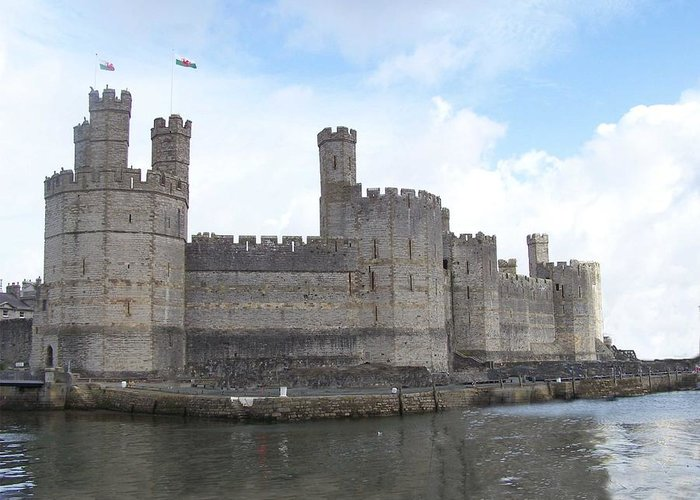 Castles Greeting Card featuring the photograph Caernarfon Castle by Christopher Rowlands