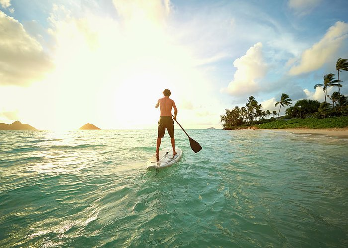 Tranquility Greeting Card featuring the photograph Caucasian Man On Paddle Board In Ocean by Colin Anderson Productions Pty Ltd