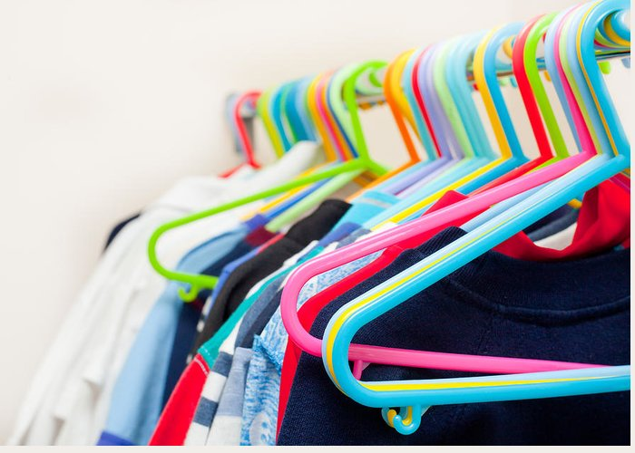 Apparel Greeting Card featuring the photograph Clothes Hangers by Tom Gowanlock