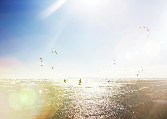 Water's Edge Greeting Card featuring the photograph Kite Surfers by Nick David