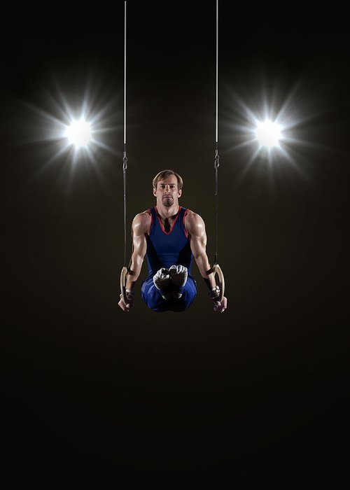 Expertise Greeting Card featuring the photograph Male Gymnast On Rings by Mike Harrington