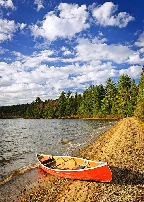 Canoe Greeting Card featuring the photograph Red Canoe On Lake Shore by Elena Elisseeva
