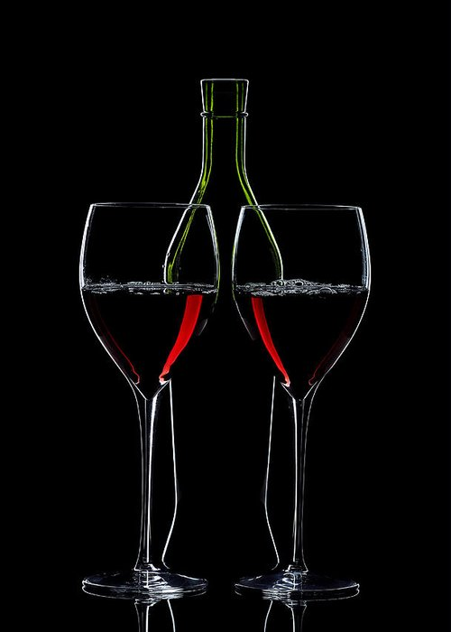 Wine Greeting Card featuring the photograph Red Wine Bottle And Wineglasses Silhouette by Alex Sukonkin