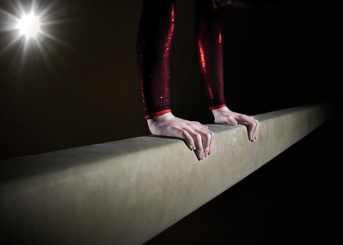 Human Arm Greeting Card featuring the photograph Female Gymnast On Balancing Beam by Mike Harrington