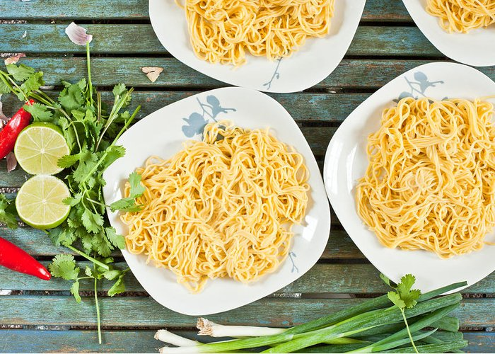 Background Greeting Card featuring the photograph Noodles by Tom Gowanlock