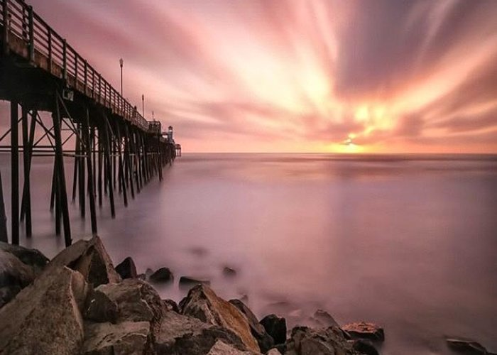 Greeting Card featuring the photograph Long Exposure Sunset At The Oceanside by Larry Marshall