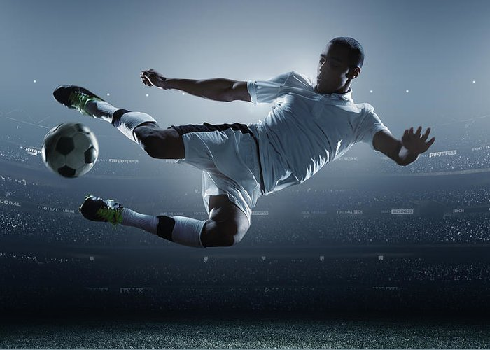 Goal Greeting Card featuring the photograph Soccer Player Kicking Ball In Stadium by Dmytro Aksonov