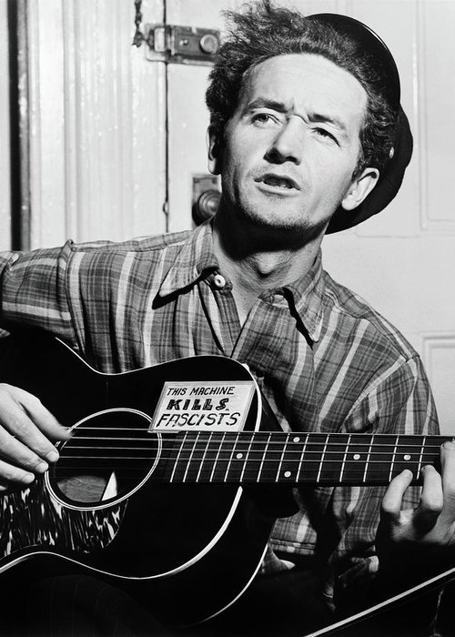 1943 Greeting Card featuring the photograph Woody Guthrie (1912-1967) by Granger