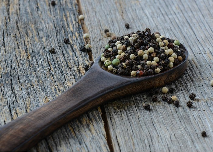 Black Greeting Card featuring the photograph Peppercorn And Spoon by Brandon Bourdages