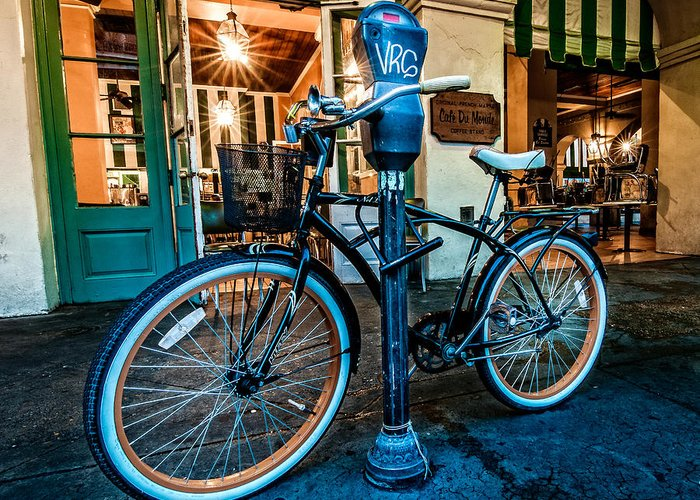 Andy Crawford Greeting Card featuring the photograph A Bike In Front Of Cafe Du Monde In New Orleans by Andy Crawford