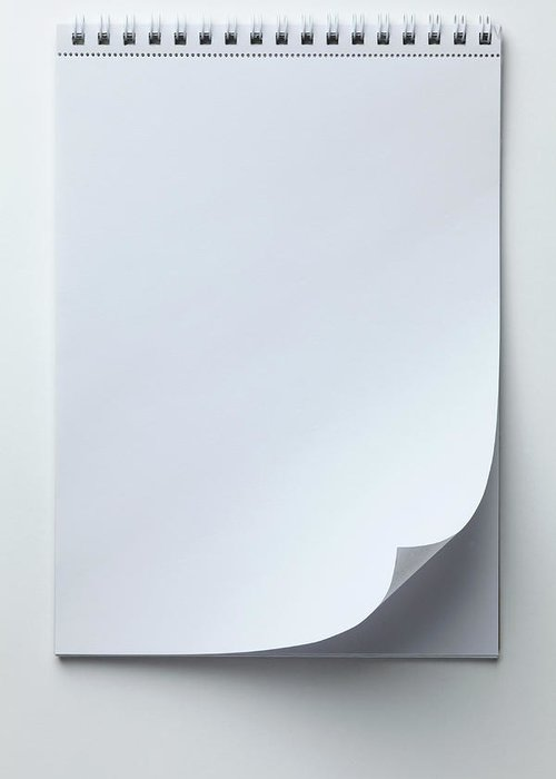 Shadow Greeting Card featuring the photograph A Blank Sketch Pad With Curled Up Page by Caspar Benson