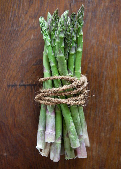Kitchen Greeting Card featuring the photograph A Bundle Of Asparagus by Halfdark