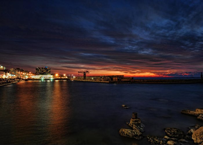 Israel Greeting Card featuring the photograph a flaming sunset at Tel Aviv port by Ron Shoshani