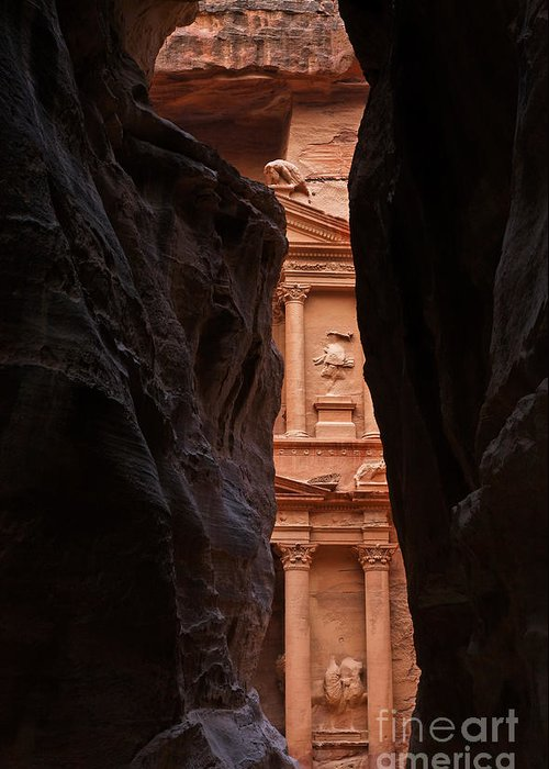 Treasury Greeting Card featuring the photograph A Glimpse Of Al Khazneh From The Siq In Petra Jordan by Robert Preston