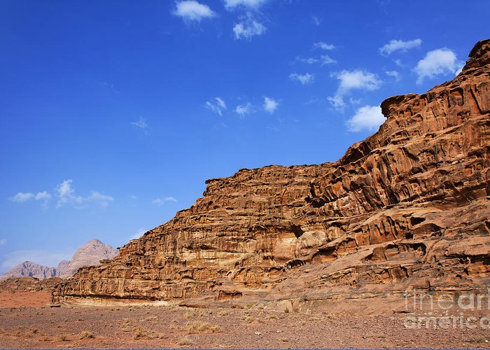 Wadi Rum Greeting Card featuring the photograph A Landscape Of Rocky Outcrops In The Desert Of Wadi Rum Jordan by Robert Preston