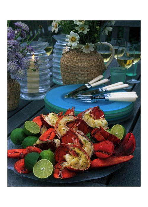Still Life Greeting Card featuring the photograph A Meal With Lobster And Limes by Romulo Yanes