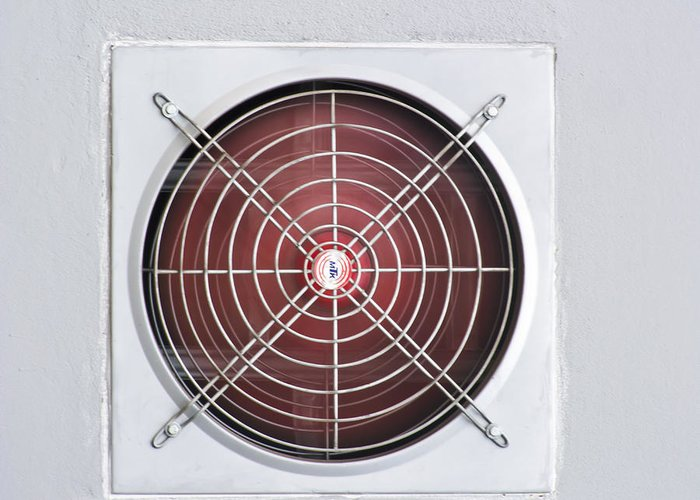 Air Greeting Card featuring the photograph A Red Industrial Ventilated Fan On Grey Wall by Ammar Mas-oo-di