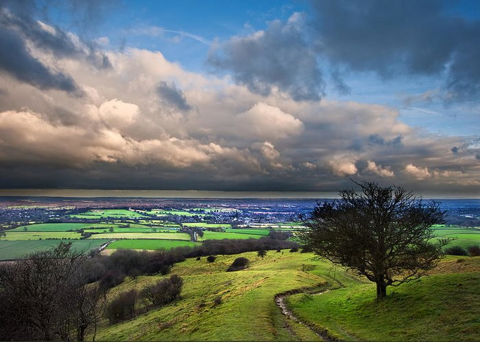 Landscape Greeting Card featuring the photograph A Storm Over English Countryside With Dramatic Cloud Formations by Matthew Gibson