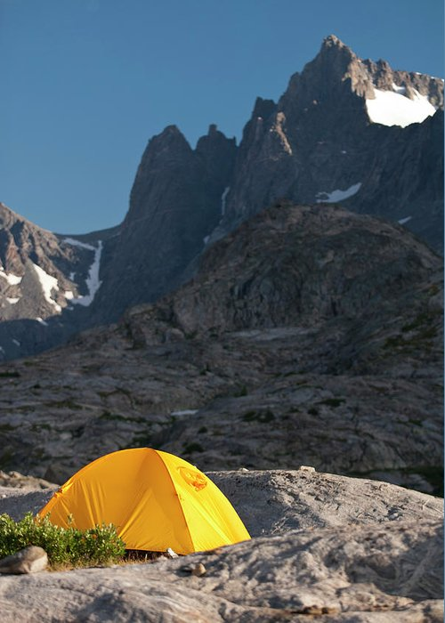 Adventure Greeting Card featuring the photograph A Tent Is Dwarfed By The High Peaks by Jeff Diener
