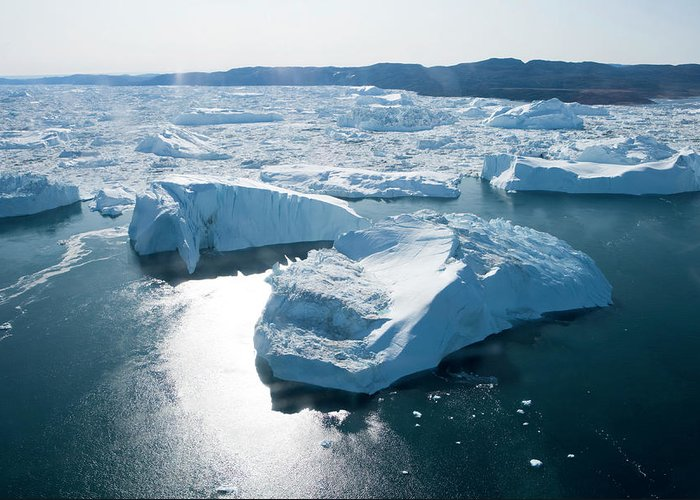Melting Greeting Card featuring the photograph Aerial Of Icebergs Of Ilulissat by Holger Leue